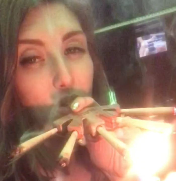 Mia Jane smoking RAW 5 joint holder