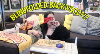 Rolling a backwoods blunt blindfolded...I cried