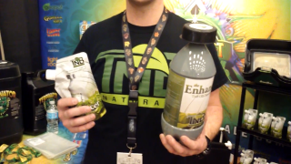 Josh from TNB Naturals Showing me The Enhancer CO2 Product at the Indo Expo